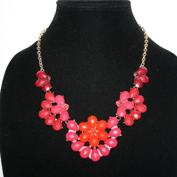 Beautiful gold and red flower bib style necklace